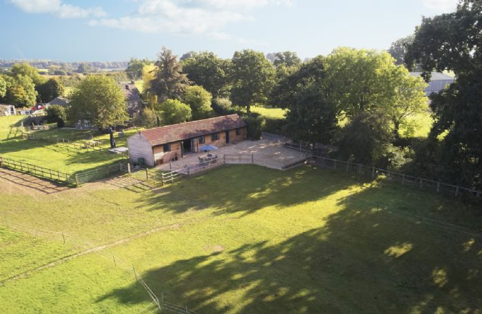 Aerial view of Oak Tree Barn and its beautiful surrounding countryside