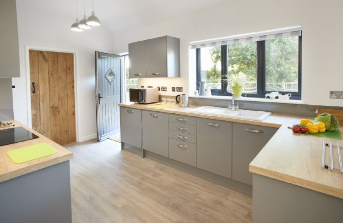Ground floor: Fully equipped kitchen with plenty of natural light