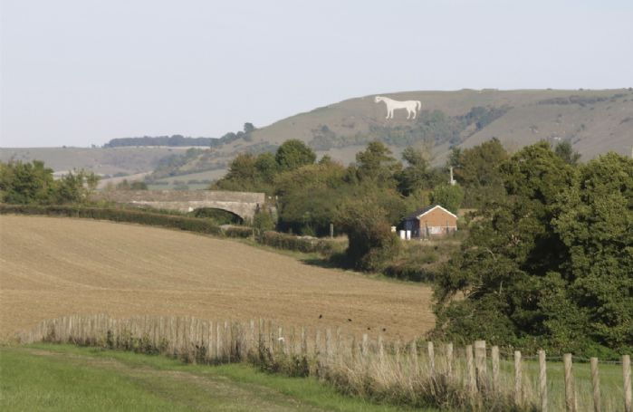 The Bratton White Horse lies just below an Iron Age hill fort and is the oldest of several white horses carved in Wiltshire