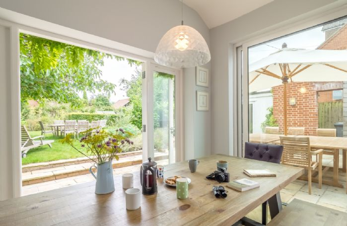 Ground floor: Kitchen with dining area and doors leading to the enclosed garden