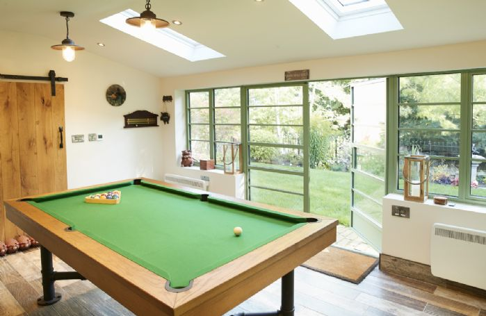 The Piggery games room features a pool/snooker table with table tennis table top