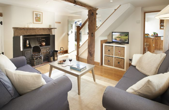 Ground floor: Sitting room with open range fire