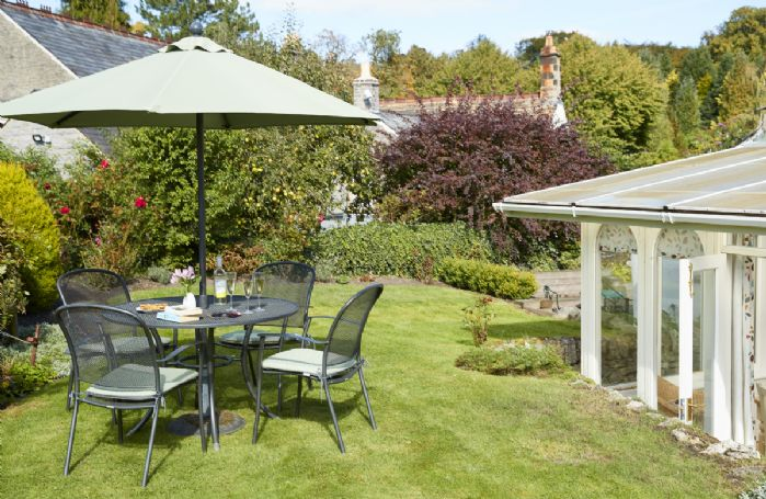 Lovely south-west facing garden with garden furniture and barbecue