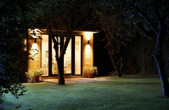 Beautiful lighting illuminates the summer house at night