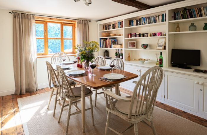 Ground floor: Dining room with cosy wood burning stove