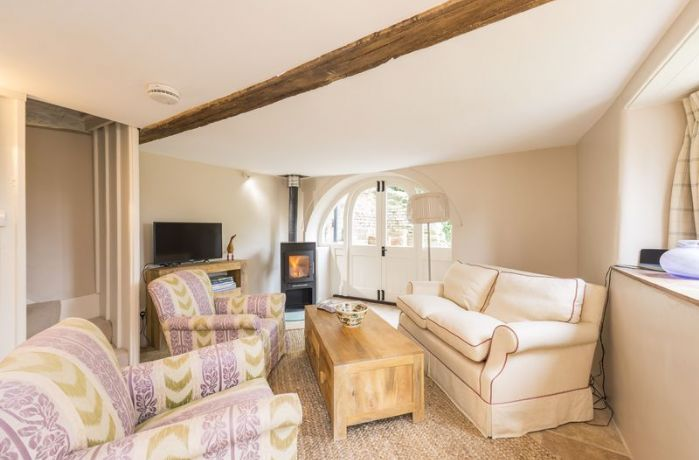 Ground floor: The comfortable sitting room with traditional beams and wood burning stove