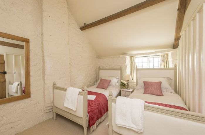First floor: Bedroom with twin single beds and oak beams
