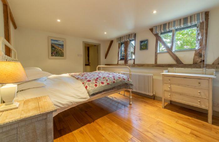 Butley Barn ground floor: Bedroom five with standard double bed