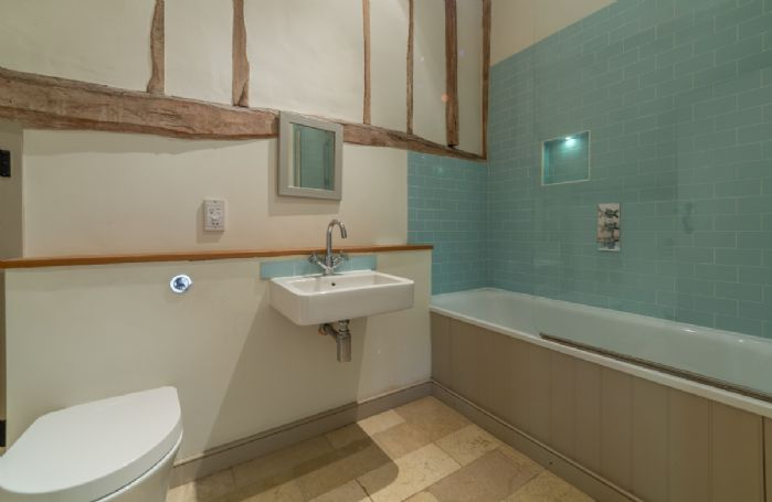 Butley Barn first floor: Master bedroom en-suite with shower over the bath and access to Dormitory via separate door