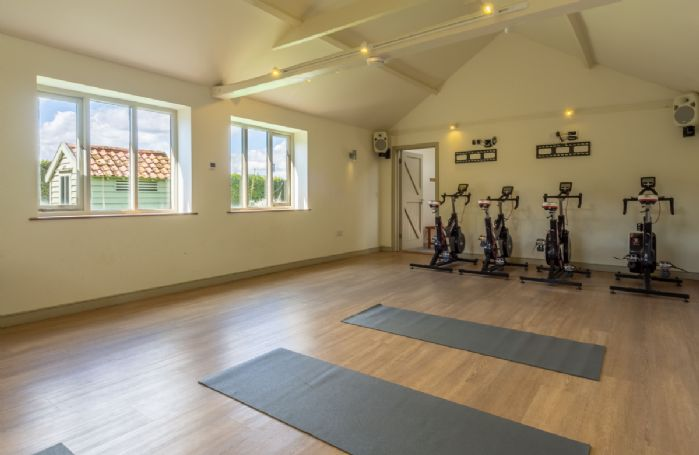 Gym space with exercise bikes and yoga mats