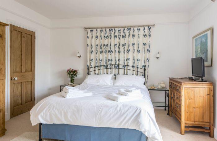 First floor: Bedroom with 5' king size bed and en-suite bathroom