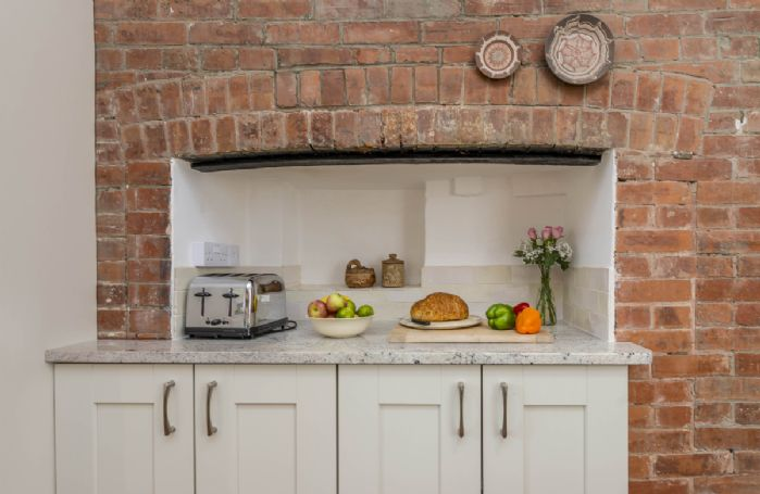 Ground floor: Exposed brick in this magnificent farmhouse kitchen