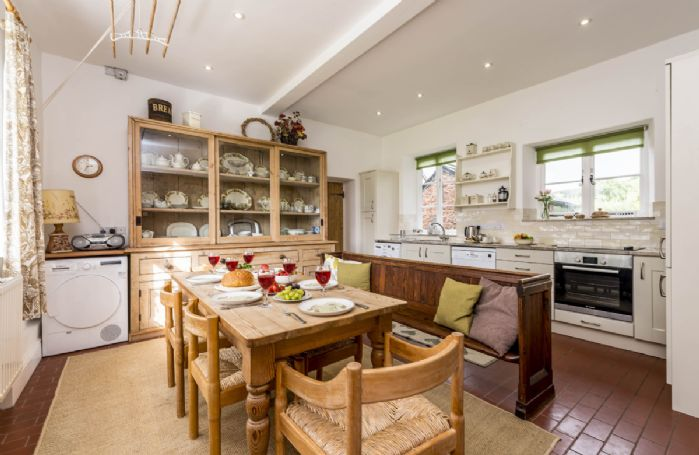 Ground floor: Fully equipped farmhouse kitchen with dining table seating six guests