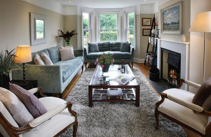 Ground floor: At the heart of the house is a spacious and sunny sitting room with a log fire