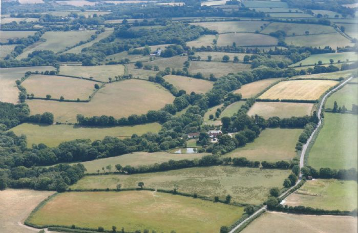 Aerial view of Woodland Cottage and its stunning rural location