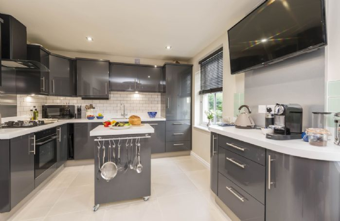 Upper ground floor: Well equipped open plan kitchen