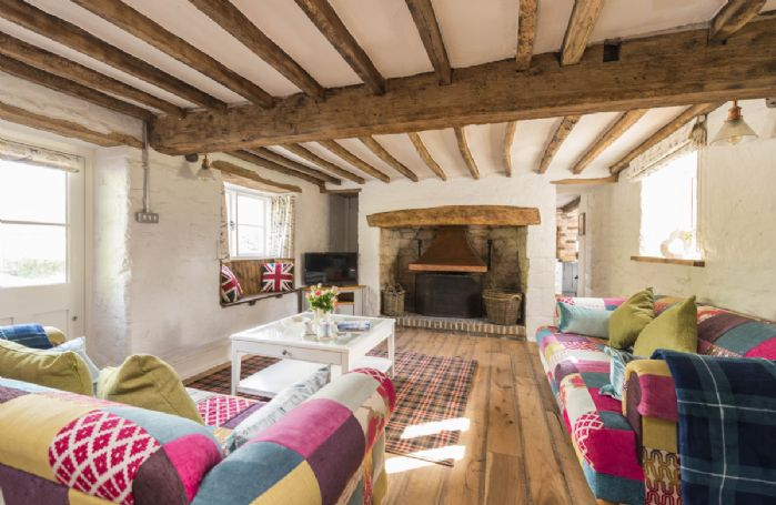 Ground floor: Spacious sitting room with open fire and exposed beams