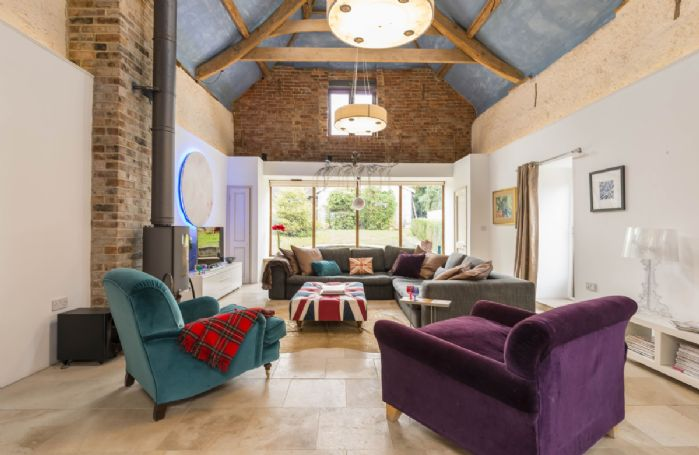 Ground floor: Spacious sitting room with a wood burning stove and underfloor heating