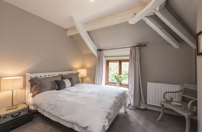 First floor: Bedroom with 4'6 double bed, wooden cot and radio