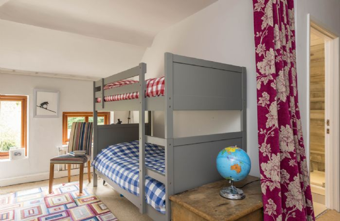 First floor: Bedroom with twin single bunk beds suitable for children