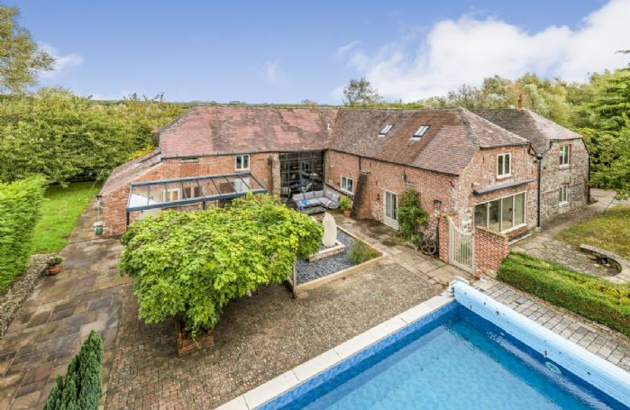 The Water Barn is a spacious, unique and stylish property with a heated swimming pool