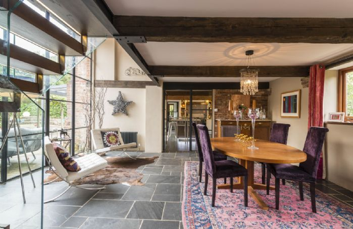 There is a sense of the original country dwelling throughout, with some exposed stone walls and original beams