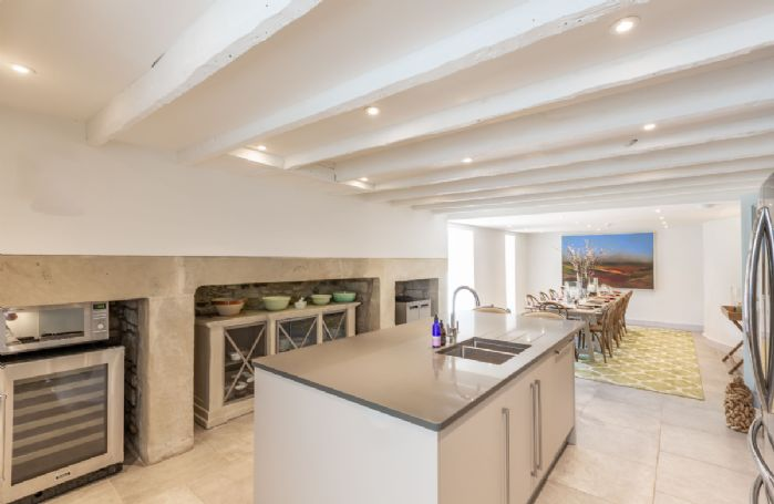 Ground floor: The well-appointed kitchen with central island and long dining table