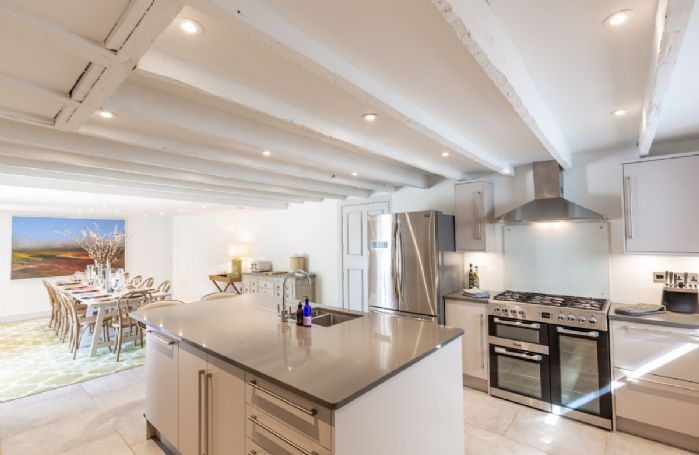 Ground floor: State-of-the art kitchen with central island and long dining table