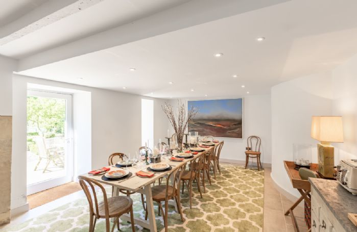 Ground floor: Dining table seating twelve guests