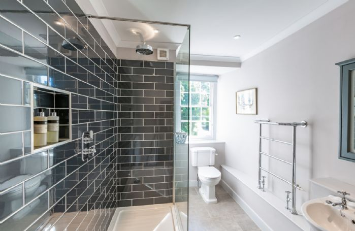 Second floor: Shower room with large walk-in shower and heated towel rail