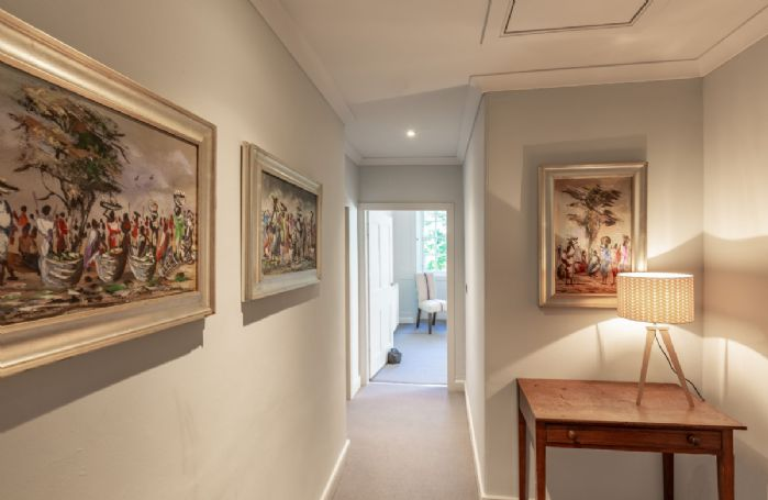 Beautiful paintings adorn the property with stylish furnishings