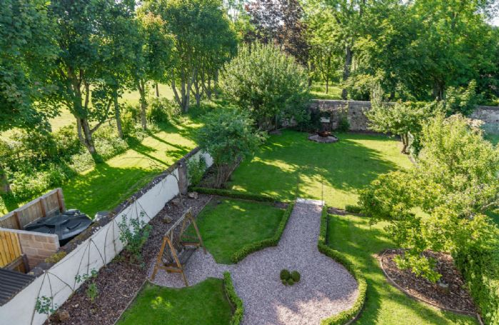The beautifully landscaped walled garden