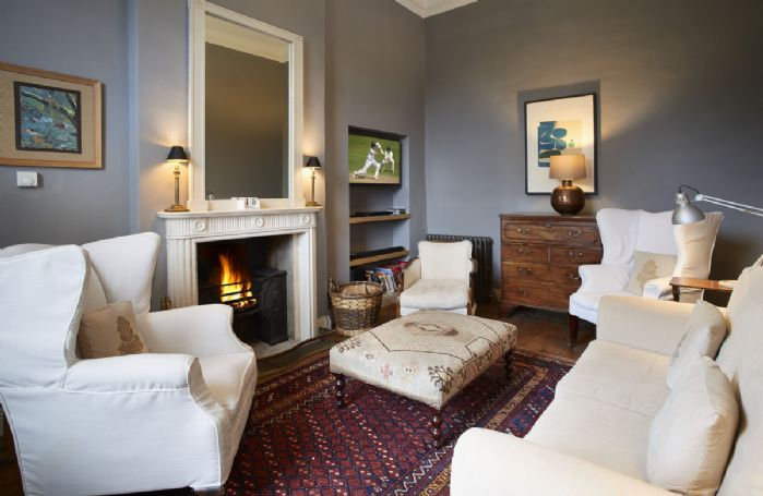 Ground floor: Cosy sitting room with open fire