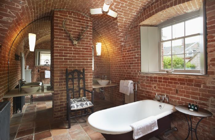 Ground floor: Vaulted ceiling in this state of the art bathroom