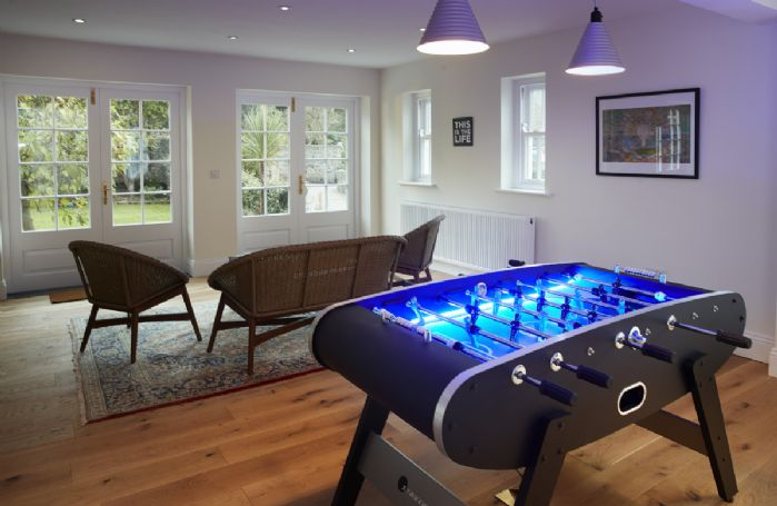 Lower ground floor: Large games room with table football and French windows leading to west facing patio