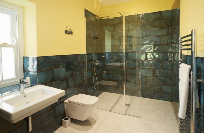 Ground floor: En-suite shower room with large walk in shower