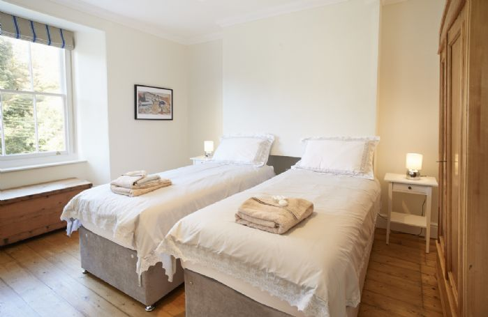 First floor: Bedroom with 6 ft super king size zip and link beds