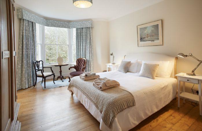 First floor: Master bedroom with 6' super king size bed, en-suite bathroom and bay window overlooking the garden