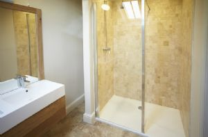 First floor:  En-suite to master bedroom with a natural limestone tiled walk in shower