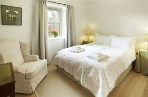 First floor: The Manor Room with three steps to a quiet private en suite bedroom with a king size (5ft) bed which can be arranged as two single beds upon request