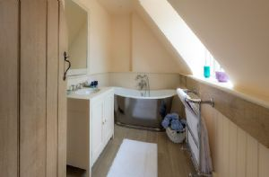 First floor:  En-suite bathroom with free standing bath