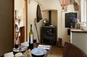 Ground floor:  Kitchen with Esse wood-fired range cooker which heats the cottage