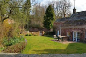 Private front and rear gardens as well as full access to 20 acres of woodland walks