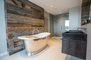 En suite to the master bedroom with freestanding claw foot bathtub