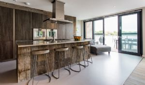 First floor open plan kitchen with views over Longdoles lake