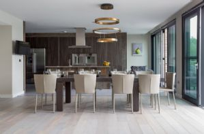 Dining area with views over Lake Logdoles, byfolding doors onto the ground floor terrace