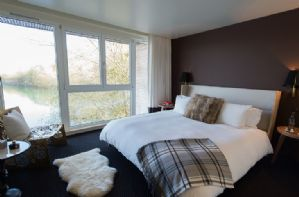 The bedrooms all have uniterupted views over Huntmans lake
