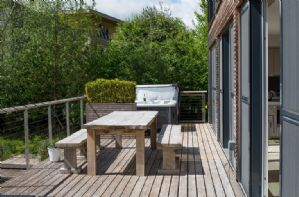 Large outdoor terrace area with garden furniture and BBQ