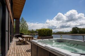 Outdoor terrace area with beautiful uninterupted views of Bowmoor lake