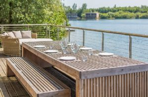 Lechlade Lodge has a glorious south facing deck, with barbecue and comfortable outdoor furnishings